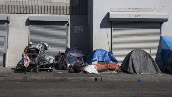 An encampment of homeless people along 6th Street on skid row this week.