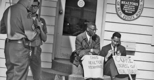 Partcipants of a fair housing protest that took place in Seattle in 1964. The Fair Housing Act was signed by LBJ just four years later, in 1968, in the wake of Martin Luther King Jr.'s assassination. Now, advocates worry the law is under threat.