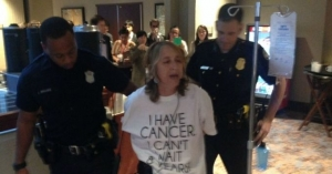 Protesting Big Pharma 'Death Sentence,' Cancer Patient Arrested Outside TPP Talks