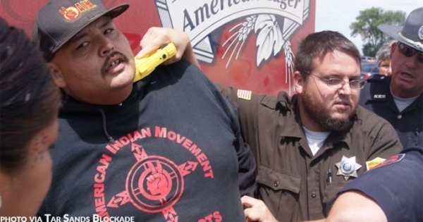 Cops Hold Tasers to Necks and Hearts of Lakota Protesters Trying to Stop Budweiser Trucks