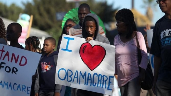 Supporters of the Affordable Care Act march in the 29th annual Kingdom Day Parade on Jan. 20, 2014, in Los Angeles.