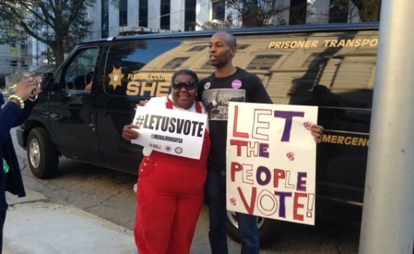 Atlanta residents protest voter suppression measures in the lead up to the 2014 election.
