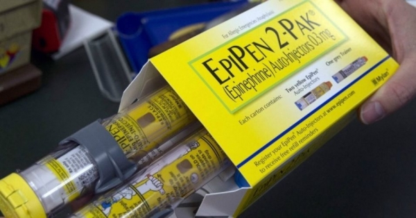 A pharmacist holds a package of EpiPens epinephrine auto-injector, a Mylan product, in Sacramento, Calif., last month. Mylan said it will make available a generic version of its EpiPen, as criticism mounts over the price of its injectable medicine.