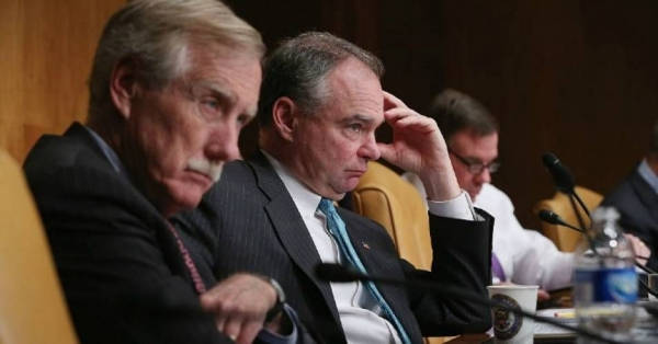 Senate Budget Committee members Sen. Angus King (I-Maine) and Sen. Tim Kaine (D-Va.) listen to testimony from Congressional Budget Office Director Keith Hall during a hearing in the Dirksen Senate Office Building on Capitol Hill.