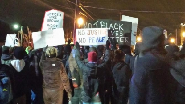 Protesters in Ferguson, Mo., on Nov. 25, 2014, respond to the St. Louis County grand jury decision not to indict Police Officer Darren Wilson in the killing of Michael Brown.