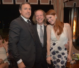 Director David O. Russell, left, Cohen and Moore at an after-party following the Screen Actors Guild Awards in 2013.
