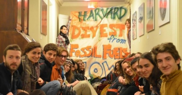 Over 30 students launched a sit-in protest at Harvard demanding divestment from the fossil fuel industry, Thursday, February 12.